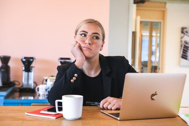 female procrastinating her work