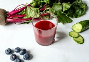 A great source of nitric oxide, beet juice on a table with ingredients