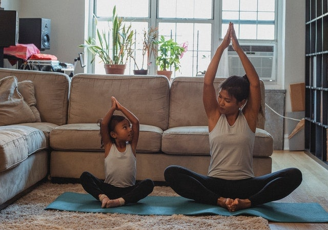 woman energized from theacrine exercises with her daughter