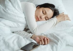 woman sleeping peacefully, benefiting from uridine