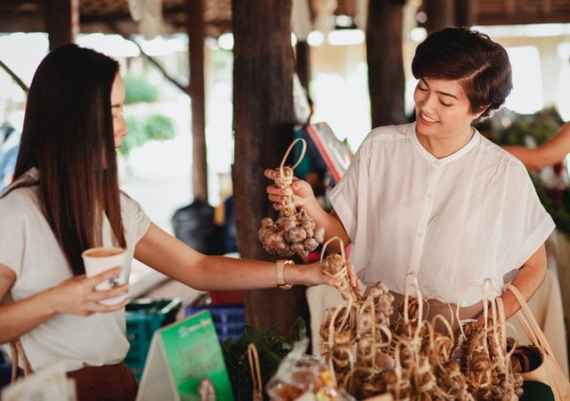 Woman chooses Ginseng, an energy supplement, at the market.