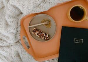 Black tea, containing Methylliberine, on an orange tray
